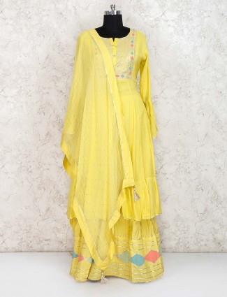 Yellow hue cotton silk fabric lehenga cum suit