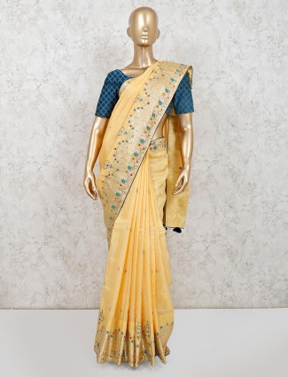 Yellow muga silk party wear saree