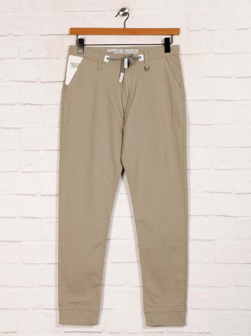 Nostrum Solid Beige Cotton Slim Fit Trouser