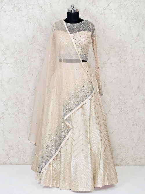 Partywear Silk Lehenga In Cream Color Embellished With Silver Detailing