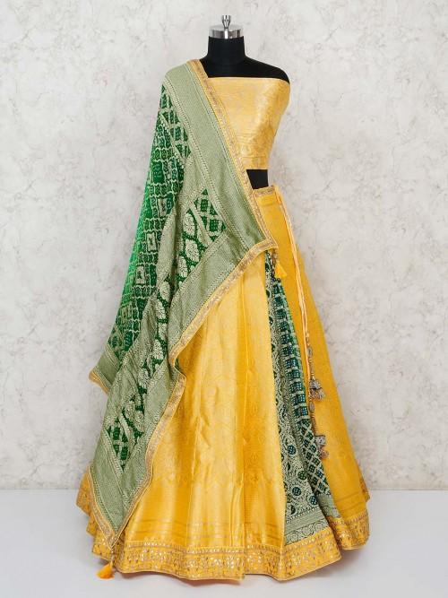 Semi Stitched Yelloow Banarasi Lehenga Choli  With Green Bandhej Dupatta