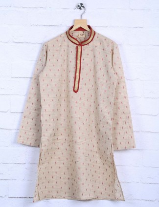Cream hued printed cotton fabric kurta suit