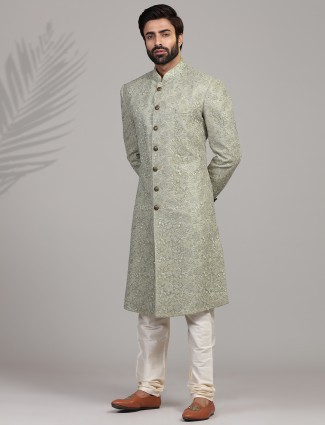 A royal green sherwani for groom