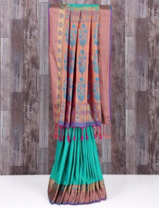 Alluring green silk wedding wear saree