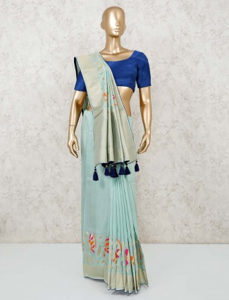 Aqua color muga silk saree with contrast blouse piece