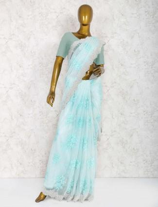Aqua hue saree in net fabric