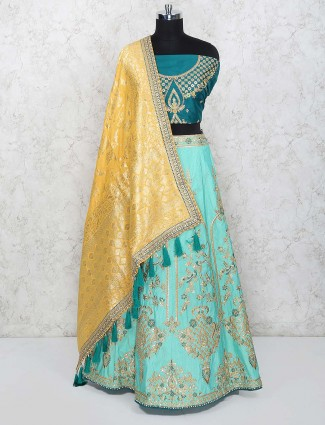Aqua hue semi stitched lehenga choli in raw silk