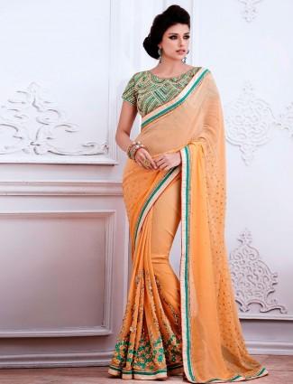Attractive peach georgette party wear saree