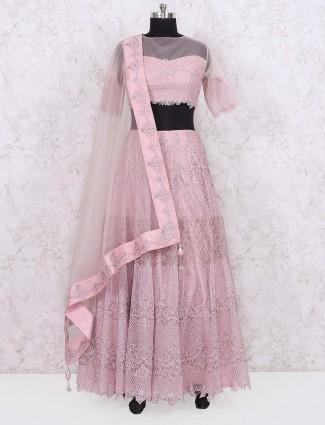 Baby pink colored net fabric wedding lehenga choli