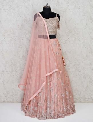 Baby pink net lehenga with the designer blouse
