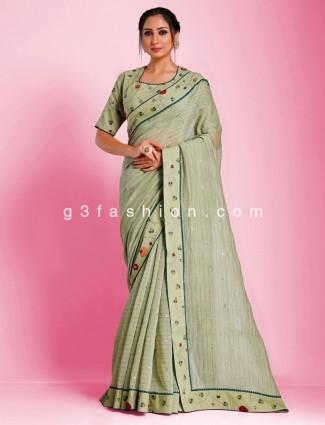 Banarasi tussar stripe woven pista green saree with readymade blouse