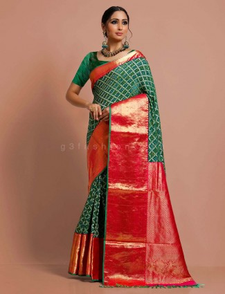 Bandhej bridal wear bottle green saree