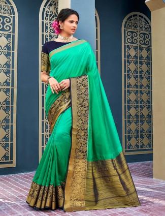 Beautiful cotton silk green festive wear saree