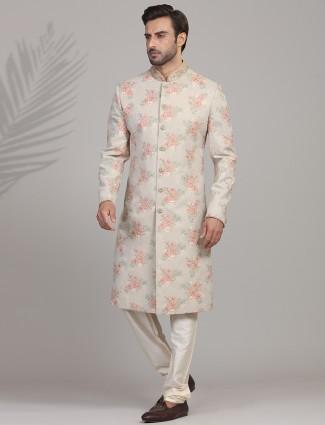 Beautifully patterned beige sherwani in silk