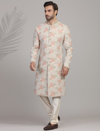 Beautifully patterned beige sherwani in silk