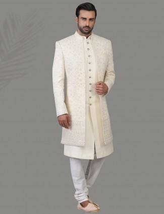 Beautifully patterned jacket style off white silk sherwani