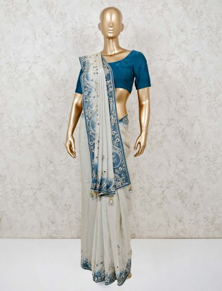 Beige and blue wedding saree in muga silk
