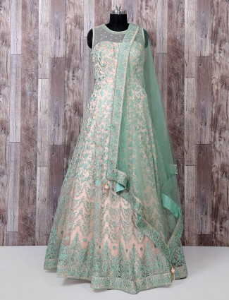 Beige and green designer anarkali suit