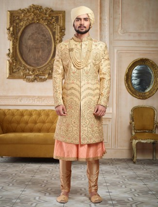 Beige and pink groom wear sherwani