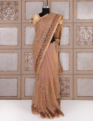 Beige color net fabric saree