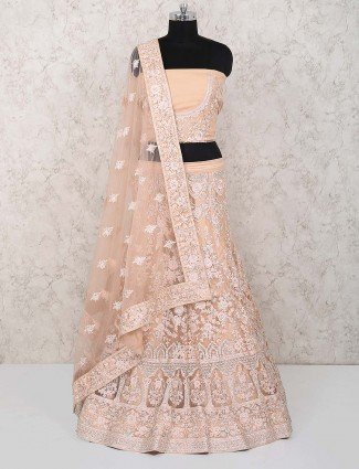 Beige color net party semi stitched lehenga choli