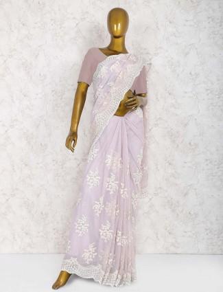 Beige color saree in net fabric