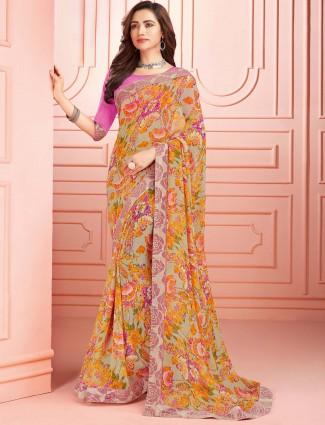 Beige colored georgette festive wear saree