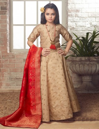 Beige colored party wear lehenga choli