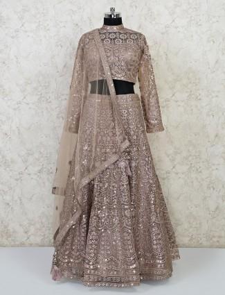 Beige colour net wedding wear lehenga choli