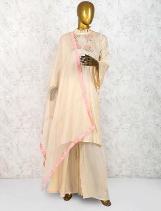 Beige hue cotton silk festive palazzo salwar suit