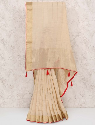 Beige hue muga silk festive saree