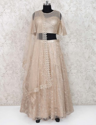 Beige hue net party lehenga choli