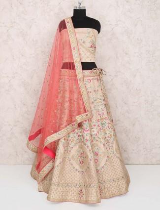 Beige hue semi stitched lehenga choli in raw silk