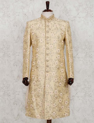 Beige hue silk wedding wear sherwani