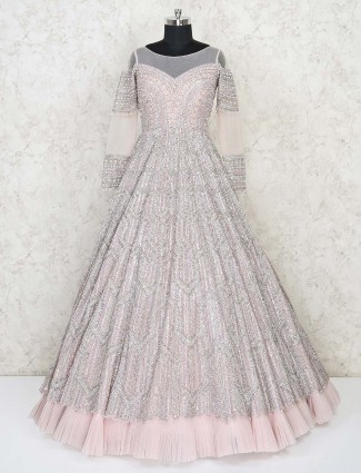 Beige net designer floor length gown for bridal