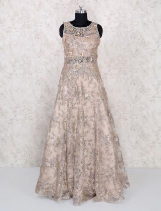 Beige net floor length gown