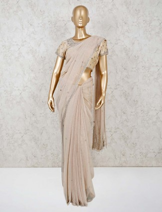 Beige net saree with the readymade blouse
