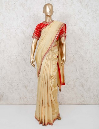 Beige saree in muga silk with embellished blouse