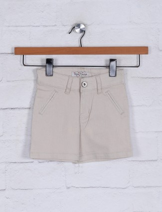 Beige solid shorts for girls