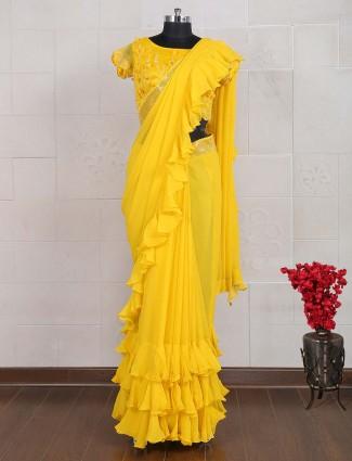 Bight yellow ruffle style georgette saree
