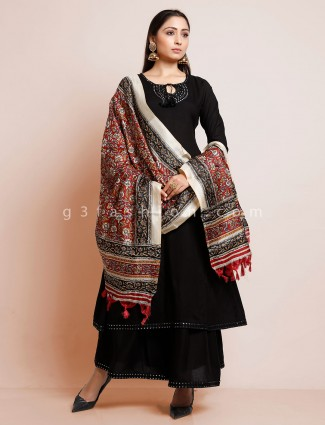 Black colored cotton flared palazzo suit with kalamkari dupatta