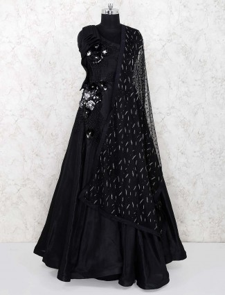 Black colored gown in satin fabric