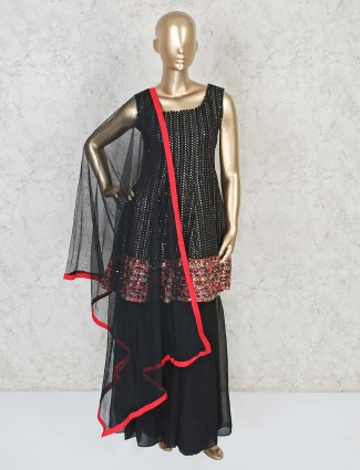 Black sequins peplum top with flared palazzo for party in georgette