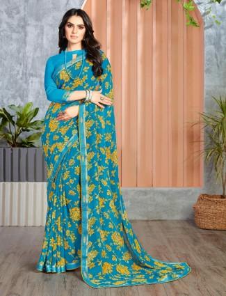 Blue georgette printed zari border saree