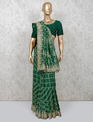Bottle green bandhej wedding saree