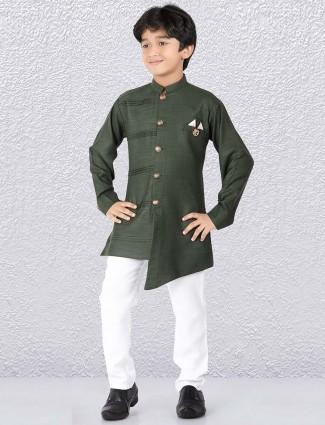 Bottle green color solid cotton kurta suit