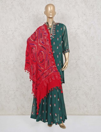 Bottle green colored sharara suit with red bandhej dupatta