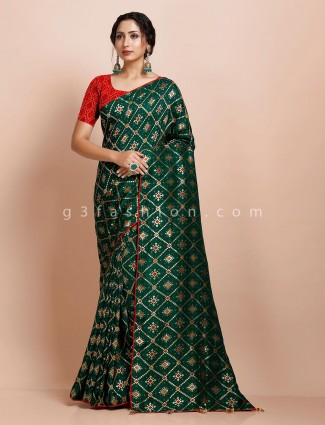 Bottle green designer muga silk saree for reception