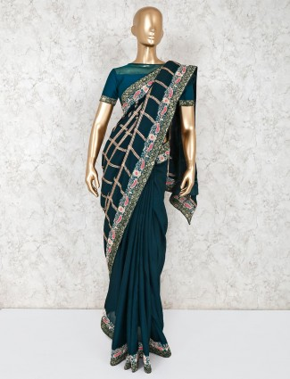 Bottle green georgette saree with readymade blouse