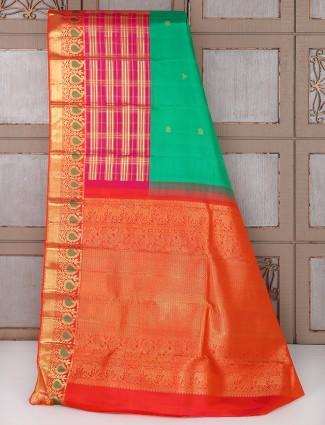 Bridal green and red kanchipuram pattu saree